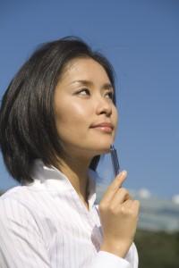 働く女性 働き者 活躍する 白いシャツ 若者